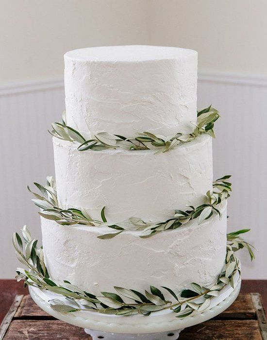 With this textured white frosting, and leafy greens, this cake is literally perfection!
