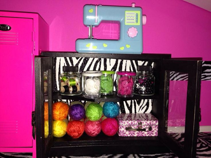 LOVE the sewing cabinet. Complete with everything to sew, supplies & even tiny rolls of yarn.
