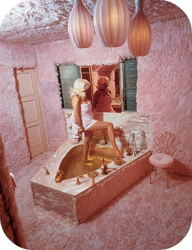 Jane Mansfield's pepto bismol pink floor to ceiling shag rug bathroom.