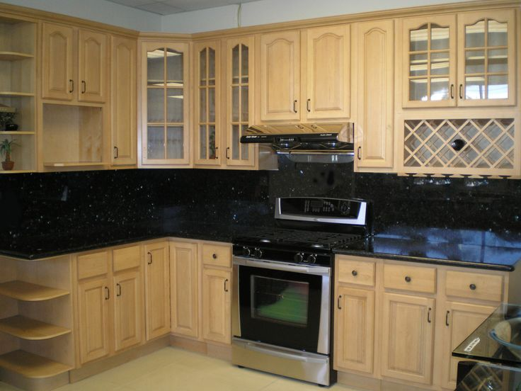 This Transitional L Shaped Kitchen Layout Features Maple Cabinets Against  Black U0026 White Wall Accents. Part 65
