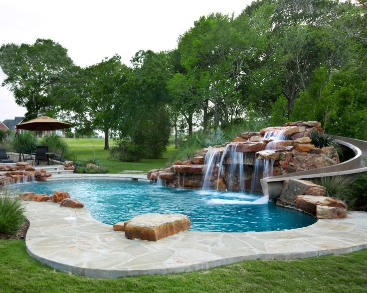 Texas custom moss rock waterfall with beautiful water slide sunset pools most beautiful pools for Citywide aquatics division swimming pool slide