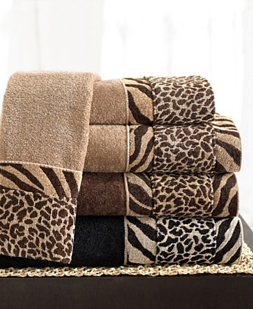 Transform the bath into a mini safari. The Cheshire hand towel is woven from smooth cotton and has a dramatic band of sheared velour zebra and cheetah prints. | Cotton | Machine washable | Imported |