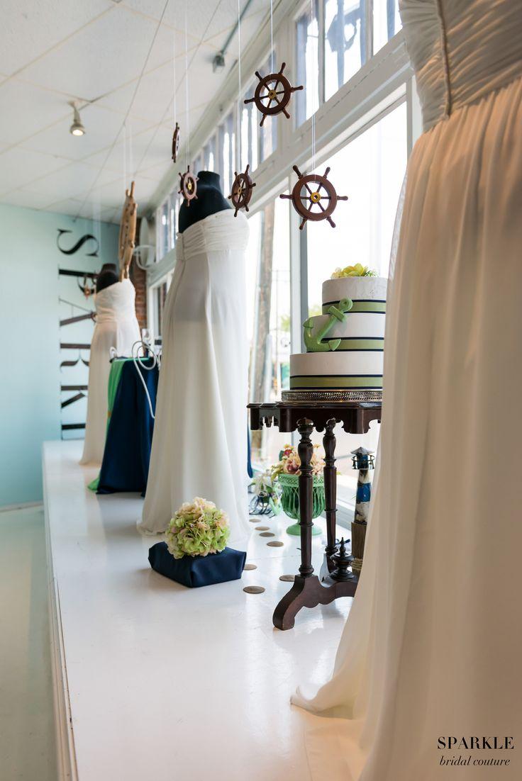 Add little hanging steering wheels among your lights for a Nautical touch.  #Helm #Steeringwheels #Nauticalwedding #Plussizebridal #Sparklebridalcouture #Weddingdecor