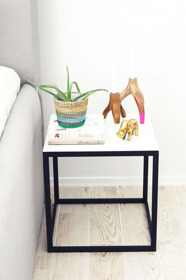 13 Chic IKEA Hacks for Your First Apartment -NASNA IKEA TABLE-PAINT BLACK-WHITE MARBLE CONTACT PAPER @MyDomaine