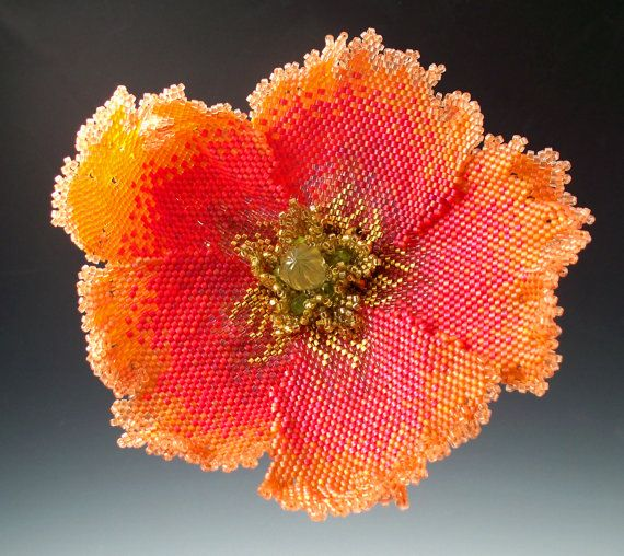 This is one of my Poppy series of brooches, inspired by the work of Georgia OKeefe. A one-of-a-kind brooch in the coral and orange tones of a poppy my