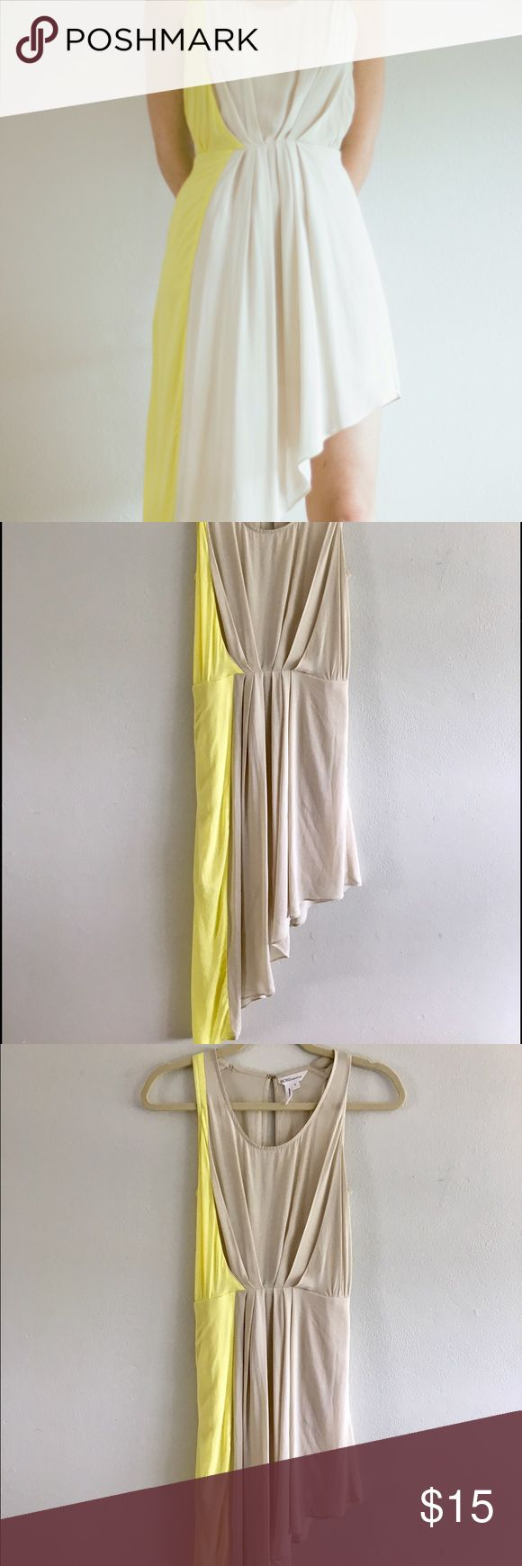 Lovely BCGG yellow and beige dress This dress has a half leg and a yellow line on the side is Effortless to dress up or down. Can take you from work to the weekend. It has an open back to give a sexy and elegant look. This fabric is soft, smooth, light and loose. 100% Rayon. Easy fit. You can wear it everywhere. Very Good Condition. Size: Small BCBGeneration Dresses High Low