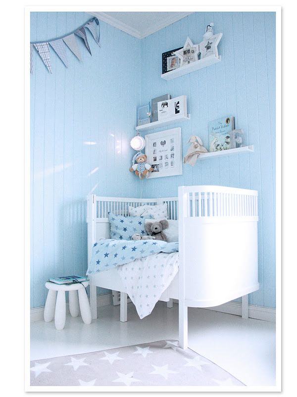 Beautiful blue & white nursery.  Doing blue walls and white furniture for our son's room! :-)