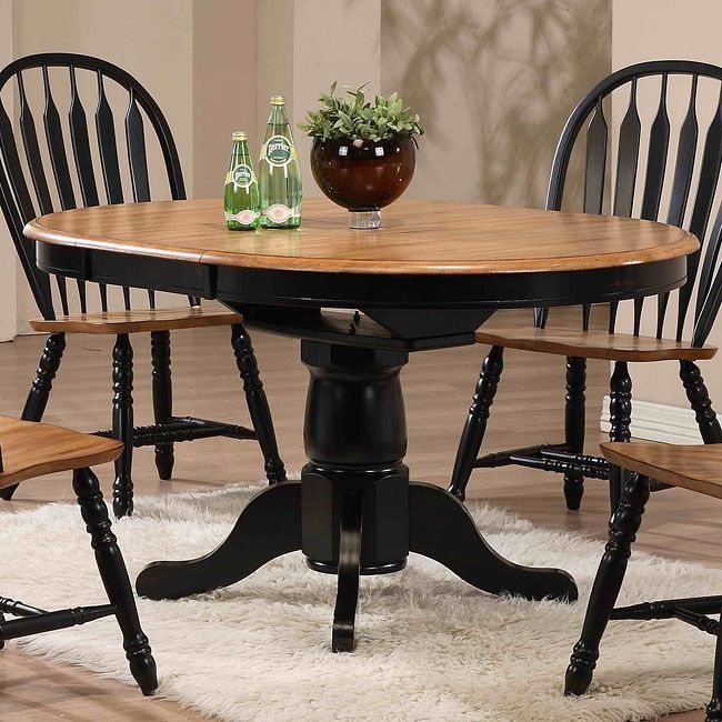 Crafted From Softly Finished Solid Oak Offset With A Striking Black Trim,  This Round Single Pedestal Dining Table Features A Turned Column Base Andu2026