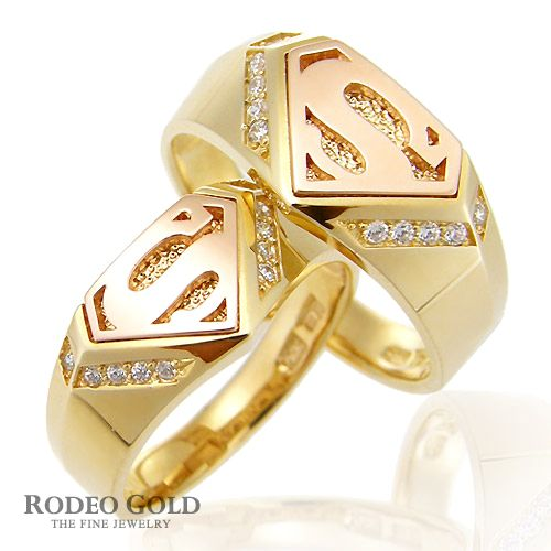 superman gold ring set with the decoration of letter - Superman Wedding Rings