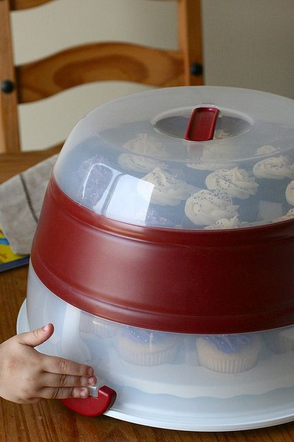 Cupcake carrier roomy enough to hold decorated cupcakes or just a regular cake. Folds down, so doesn't take up tons of storage space.