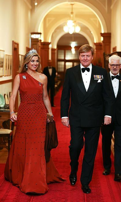 Máxima glammed up for a state dinner in New Zealand wearing a one-shoulder red gown.<br><br>Photo: © Getty Images