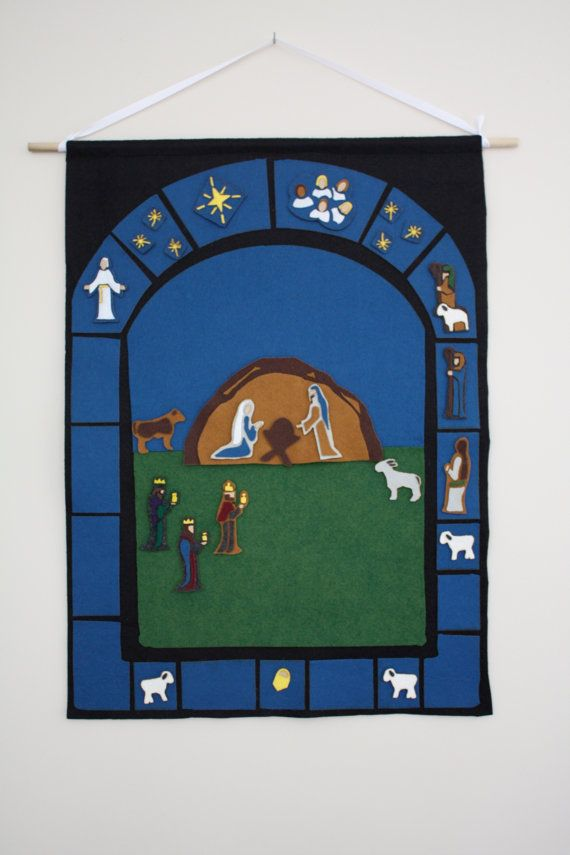 another felt advent calendar. I like how this one looks like a stained glass window. :)