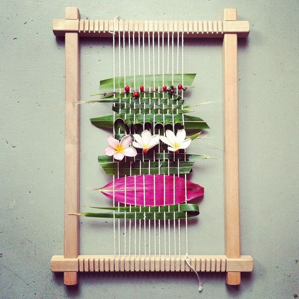 L.H. & H.C.  This is a great example of using different materials for weaving. In addition, these materials come straight from nature, and can be made into a lesson about the outdoors.