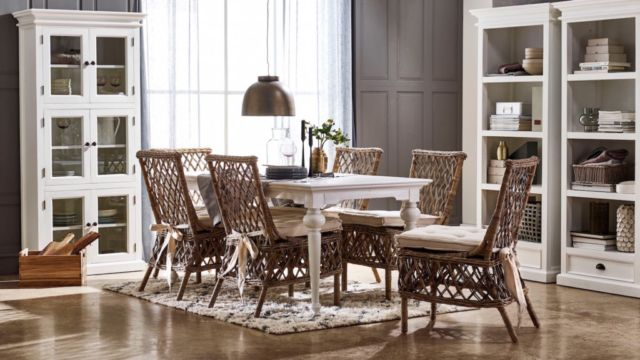The bright tone and glossy finish of this table will help to make a small room feel larger. Beneath the sleek white top, lies four trumpet-turned legs that are tapered towards the bottom to make the table feel slender and sophisticated.