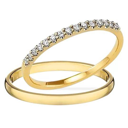 Snubné prstene pre nevestu a ženícha vyrobené zo žltého zlata a briliantov.
