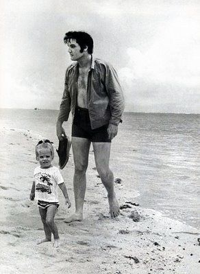 Elvis and Lisa in the beach - elvis-aaron-presley-and-lisa-marie-presley Photo