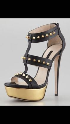 Gold and black high heel with spikes