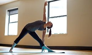 Beach Yoga and Fitness: 10 or 20 Drop-In Yoga, Fusion, Insanity or PiYo Classes at Beach Yoga and Fitness (Up to 84% Off)