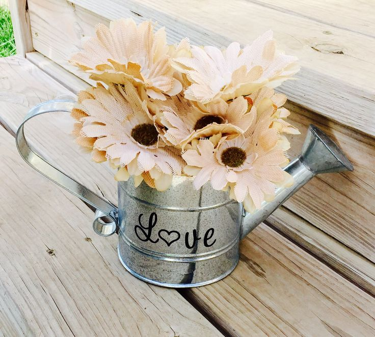 This is the perfect decorating idea for a wedding centerpiece or home decor! Fill with flowers, greenery or leave plain. This metal watering can is a home decor or wedding decor must have! These also