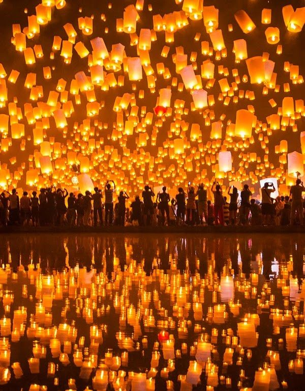Blimey, every year thousands of people gather at a remote mountain town of Pingxi district in Taiwan to celebrate the new Lunar Year by filling the night sky with over 200 000 lanterns. According to the tradition before releasing the lantern, each person should scribble their desires and ambition on it and then send it into the heavens for good luck.