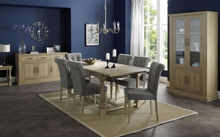 Bentley Designs Chartreuse Aged Oak Dining Set - 4-10 Extending with Smoke Grey Upholstered Chairs. Chartreuse dining is a striking example of a sturdy, versatile & stylish casual dining range that is beautifully made using American oak solids & veneers and finished in a fashionable aged oak, Central to this collection is the dining table, cleverly engineered to store two leaves that allows up to 10 seating positions when fully extended.
