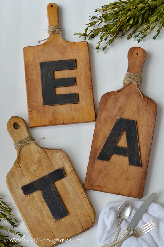 """Hometalk :: DIY Cutting Board Word Art..""""Do you have any wood cutting boards lying around that you don't know what to do with? This tutorial will show you how to easily transform them into decorative DIY word art to hang on your kitchen wall! All you need for this awesome kitchen idea are some mismatched cutting boards, letters, and twine!"""""""
