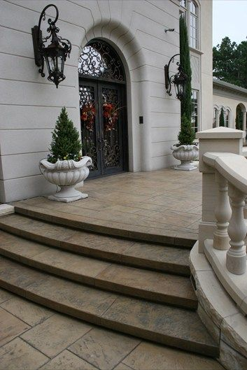 Textured brown steps curved front door steps and - Installing exterior door on concrete ...