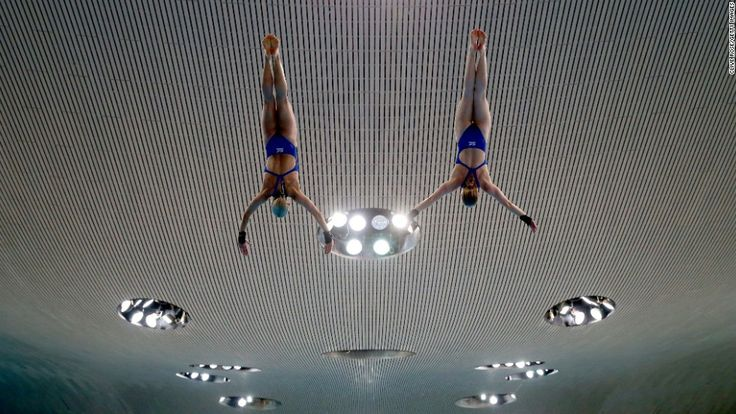 Tonia Couch and Sarah Barrow practice a synchronized dive at the FINA/NVC Diving World Series in London.