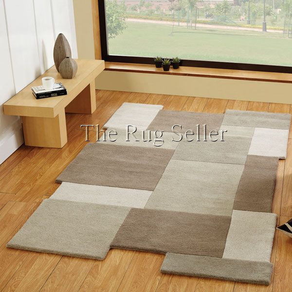 Abstract collage rugs in stone