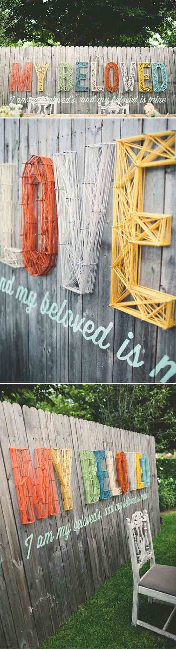 diy backyard fence decor | 15.Custom freestanding fence pimped out with wool, yarn, and nails