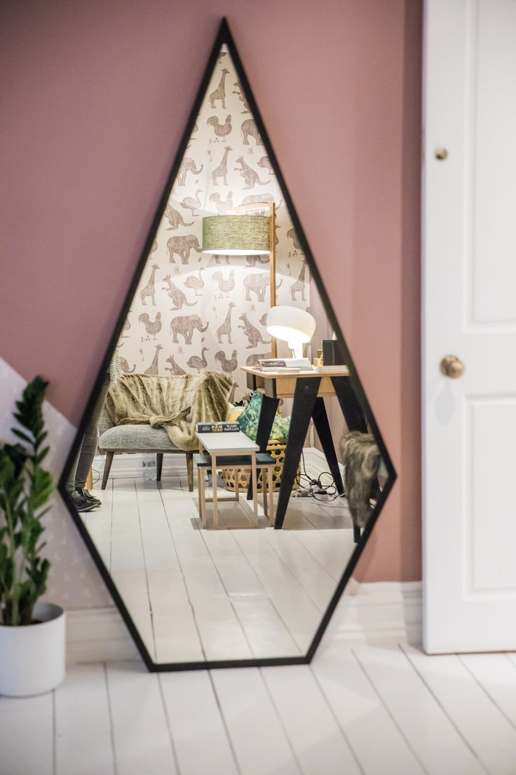 Houzz of 2018 - kids bedroom with dusky pink walls and funky geometric black mirror
