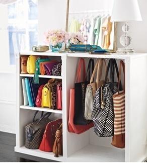 organize handbags in low boy cabinet or shelf --