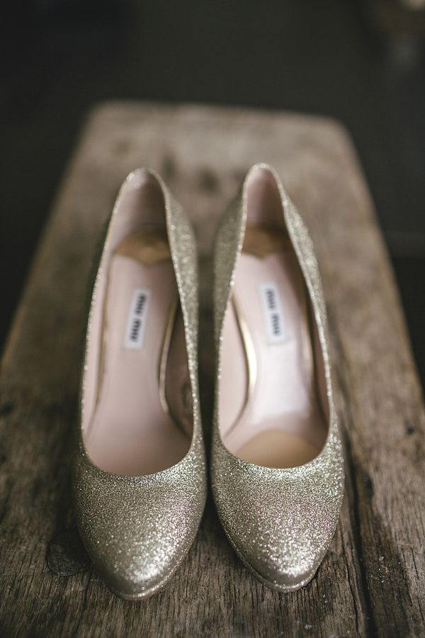 Gold sparkly wedding shoes. Photography by Kat Hill.
