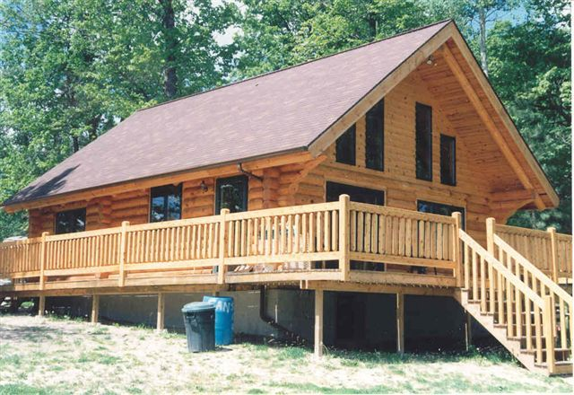 Log cabin staircases transforming small log homes with for Log cabin plans with loft