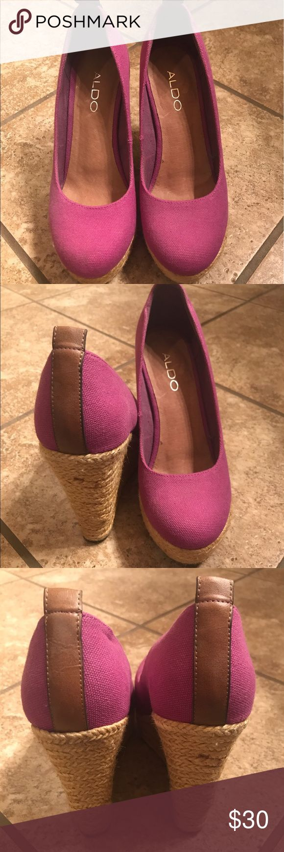 Purple Espadrille Wedge Aldo 7 This pair of wedges is by Aldo & is a size 7. They were only worn once and are in excellent condition. They are too small for my 7.5 feet. They are a purple linen fabric with rope-like wedges. Aldo Shoes Wedges