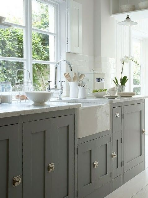 Love the color of cabinets with polished nickel hardware, Apron front sink and cararra marble tops    Refined country kitchen via Jamie Meares on Flickr.