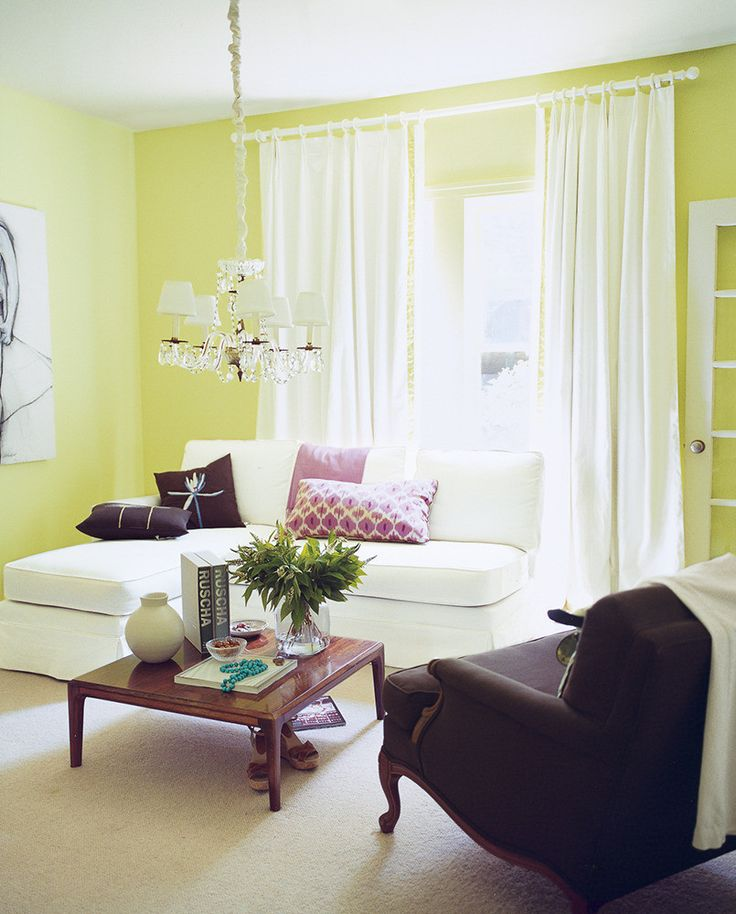 neon yellow living room walls, white curtains, pantone lime punch, bright yellow