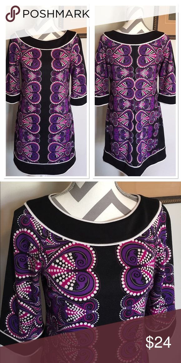 Black and Purple Paisley Shift Dress Beautiful dress. Great for all seasons. Wear as a dress or with leggings and boots. Size 6 petite. 97% polyester, 3% spandex. Black with white piping around neckline, sleeves and bottom of dress. Purple and hot pink paisley design. Good used condition! 3/4 sleeves. Bust: 17 in. Length: 33 in. new directions Dresses