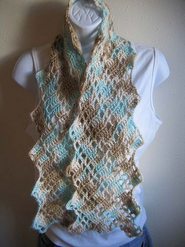 Making this now with skeins of black, white, and grey/blue yarn!