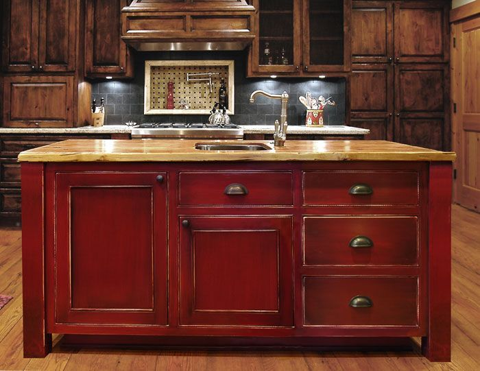 Island: red distressed look. Im painting my kitchen cabinets like this.    @Steven Mckenzie, or this??