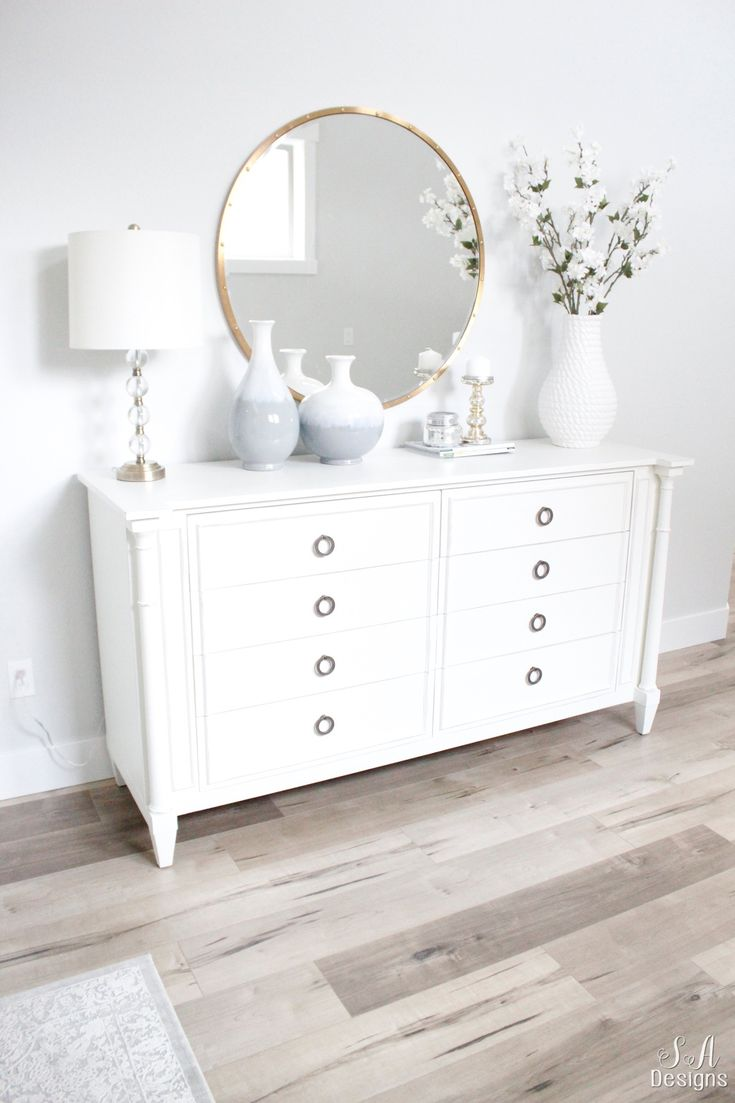 Welcome to the bright white entry of our home! See what fabulous pieces I've found to create the coastal glam style I wanted.