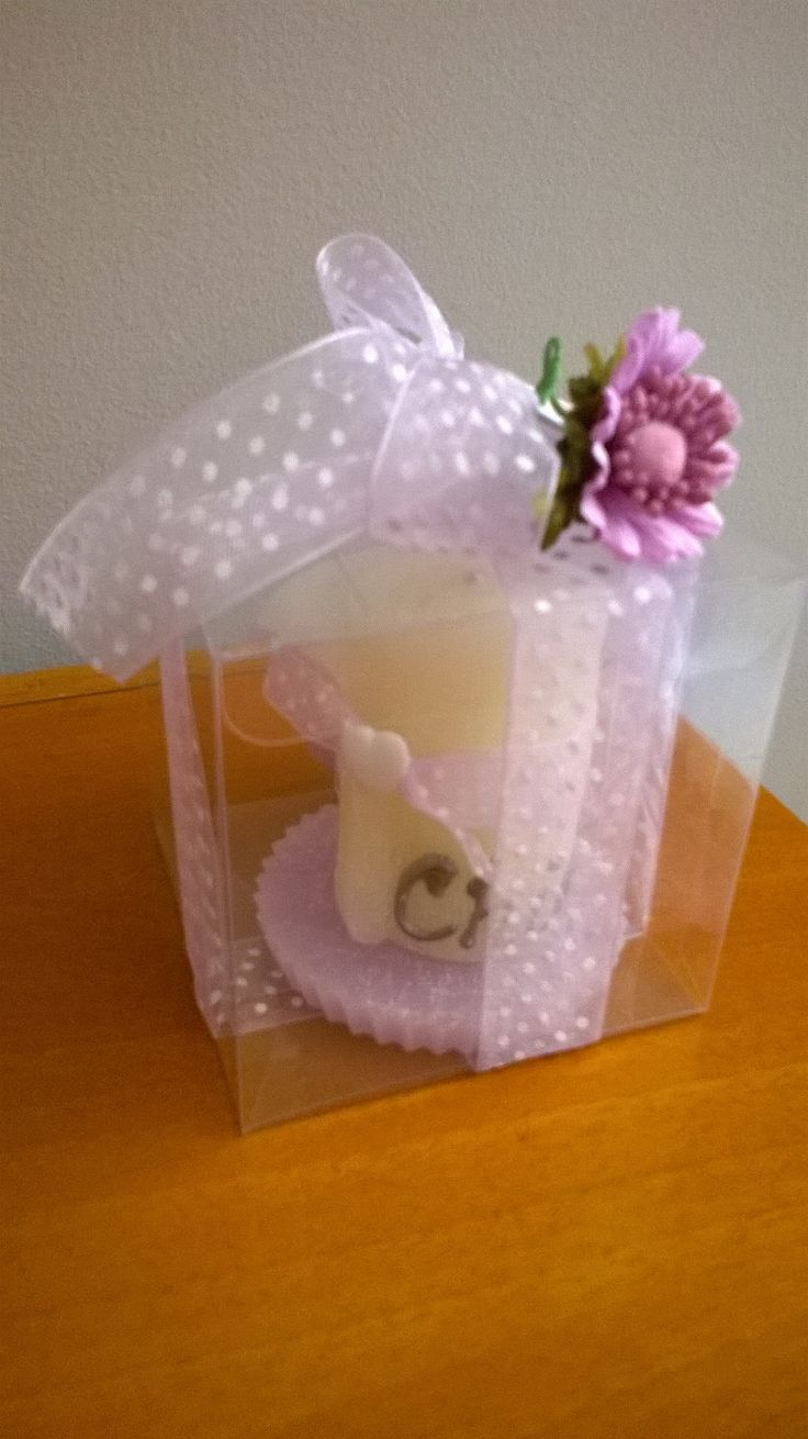 https://flic.kr/p/Jo1za3 | CHRISTENING SOUVENIR: ROLLED WHITE CANDLE | Rolled white candle above a little violet wax plate. It's decorated with 3D child's name, a coloured ribbon and a little heart-shaped white chalk. 100% natural essential oil with lemon fragrance. Size: 70 x 60 mm. It's  inserted in a rectangular transparent box (along with the coriandoli) and decorated with a ribbon and a fabric flower.  Handmade.  Read more:  www.ilmiomondoincera.com