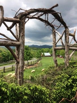 A hedge and arch created for a formal antique rose garden for Mountain landscape design
