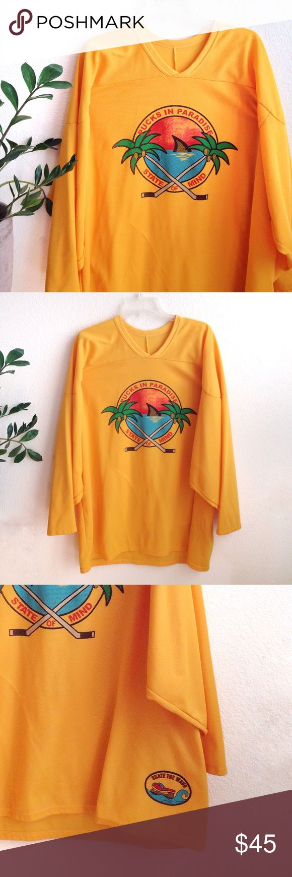 """VTG🌴70s Rad Pucks in Paradise Hockey Jersey! AMAZING! Super bright & rad oversized hockey jersey. Features groovy, pop art style Pucks in Paradise beach graphic on front with waves, sand, palm trees and hockey sticks 😝 """"Skate the Wave"""" graphic on lower right side. Very 60's style art theme going on here. Made by world-renowned Canadian hockey jersey company CCM. In flawless condition! Men's XL, but can fit on literally anyone. Unisex item! 🌴🏄🌴 Oilers Penguins Canadiens Red Wings…"""