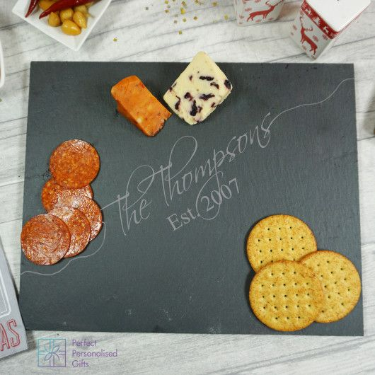Family Slate Cheeseboard.  Wanting a special gift for a close family? This personalised Family Slate Cheeseboard is the most wonderful gift, handcrafted in Yorkshire and makes a fantastic gift any time of the year.    With a beautiful script font, this personalised slate cheese board can be personalised with the family name and established date. The text 'Est.' is fixed. We are happy to discuss any design variations you may like please just contact us and we will do what we can.