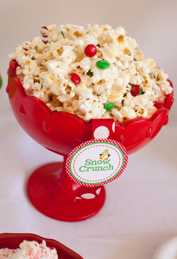 snow crunch.  popcorn drizzled with white chocolate and m's.  kid Christmas party