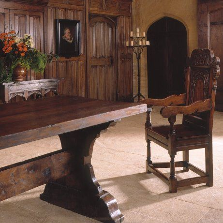 medieval trestle table in oak, with carved arm chair and parchemin