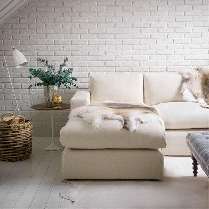 Exposed brick wall, using animal skin rugs
