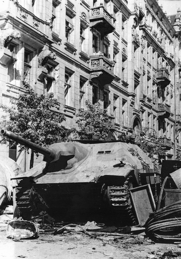 """Polish insurgents captured German tank destroyer """"Hetzer» (Jagdpanzer 38 (t) «Hetzer») at the barricade in the square at the beginning of Warsaw Uprising. August 4, 1944. This machine had the rebels name «Chwat» (blade). 