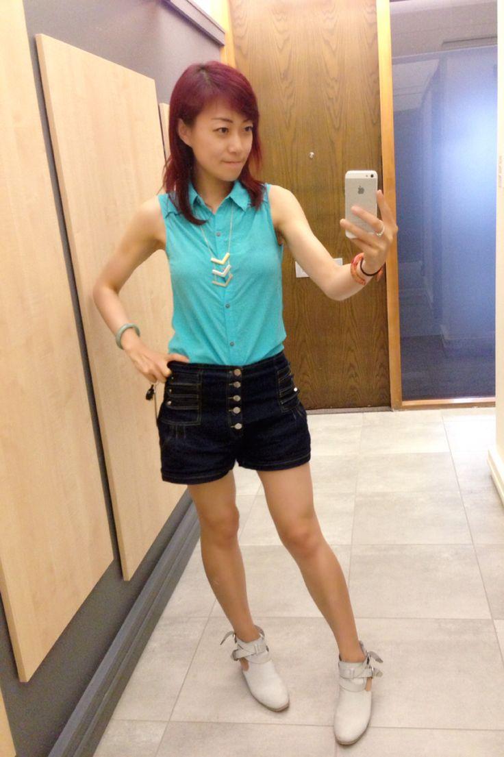 Sky blue silk sleeveless shirt, denim shorts, white shoes, smart causal Friday